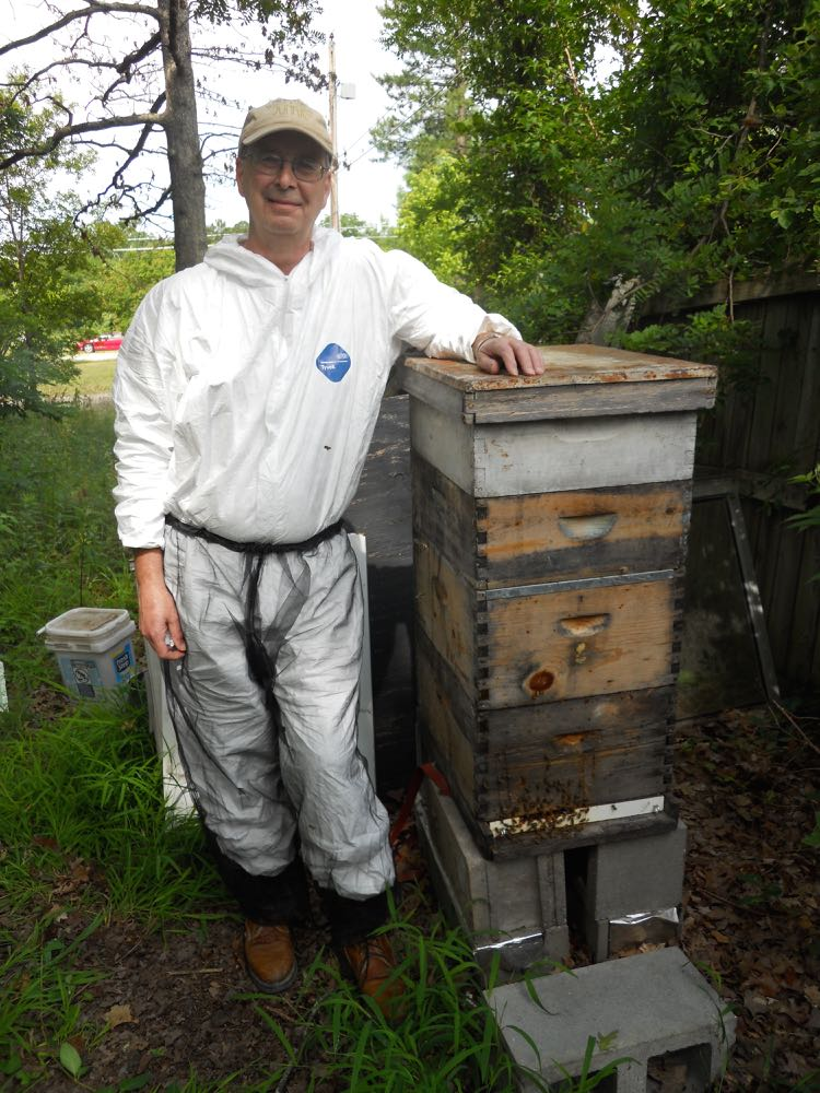 Kelly with his bee colony before we started the inspection. Note how high the hive is here!