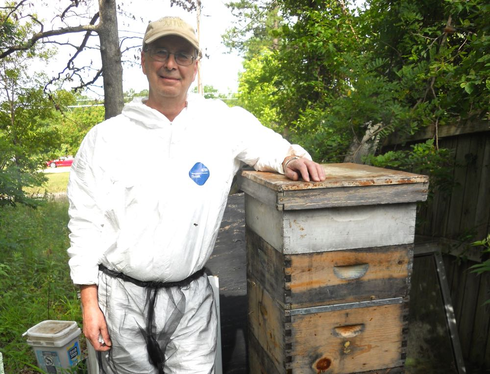 Meet my beekeeping friend Kelly and his one honeybee colony living in his back yard.