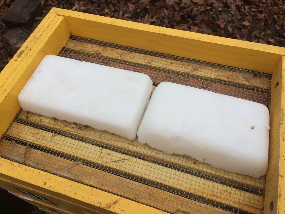 Emergency sugar cakes formed in bread pans nicely fit across my honeybee hives.