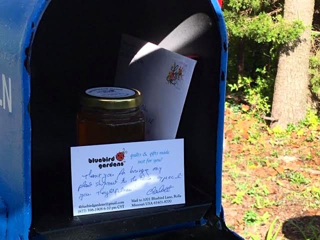 My card and honey jar in my mailbox for my considerate mail carrier. (Photo by Charlotte Ekker Wiggins)