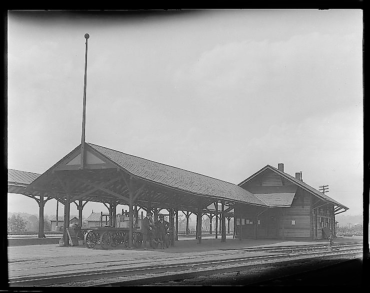 P&LE Passenger Station - Wooden station of P&LE Passenger Station from New Castle Junction taken June 7, 1917. I used my photo editor to lighten this, so we can see the station better. Problems: I ruled this out primarily because it's clearly a wooden station. But also, there's really no distinctive architectural features.