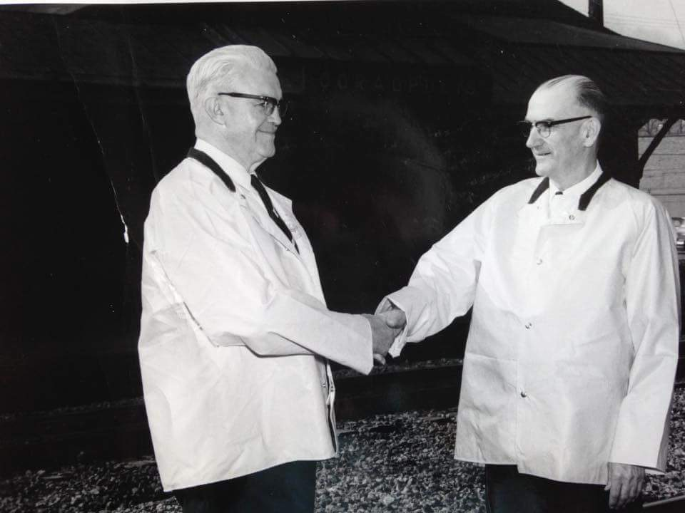 Clifford Combs and Wayne Cool receiving the safety award in 1964.