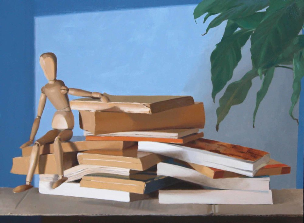 lay-figure sitting on books.jpg