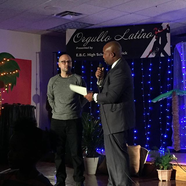 Principal Shawn Brown presenting a thank you to @arjanzazueta at the Orgullo Latino Celebration at EBC this evening. Arjan took the time out of his schedule teaching art at Illinois State University to donate his time to our students. Painting, spending time with students, and holding some interesting conversations around race, politics, and art at the school. Thank you for your Public Service Arjan, sharing your talents and razor sharp intellect raises the bar for these young minds.