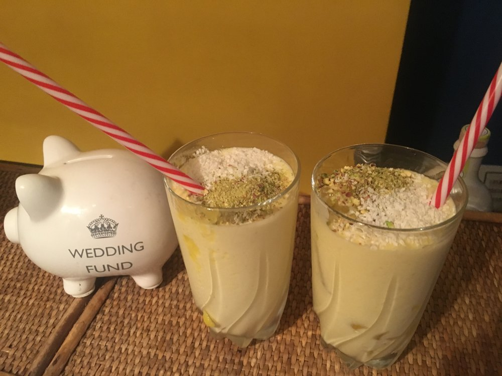 Method 1. Blend one Mango with Ice and two tbsp of Greek Yogurt 2. Top with crushed Pistachios and Desiccated Coconut 3. Serve in a tall glass and long straw for mixing 4. Yum!