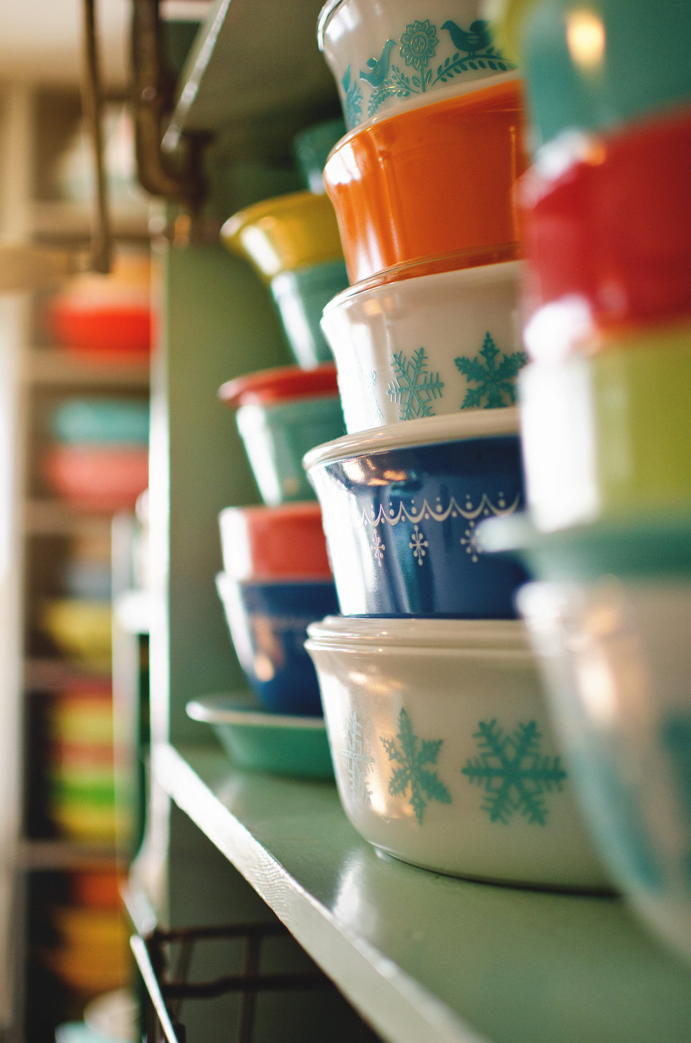 Colorful, vintage Pyrex on green shelving. H.Prall & Co. | hprallandco.com