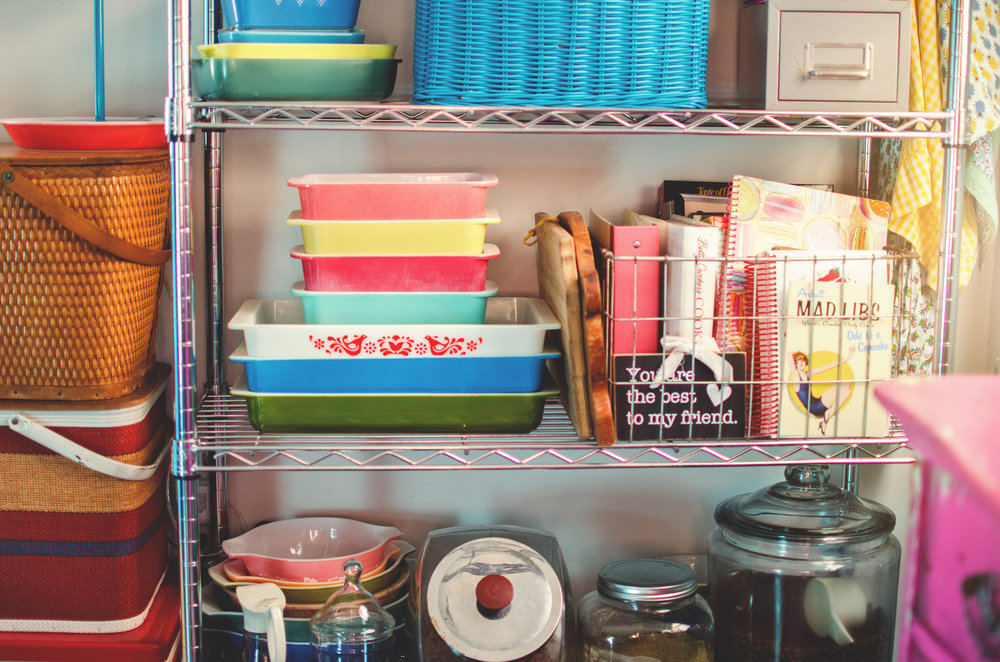 Pyrex as decor next to a vintage wire crate full of cookbooks. H.Prall & Co. | hprallandco.com