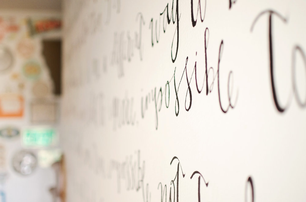 Song lyrics painted on an accent wall. H.Prall & Co. | hprallandco.com