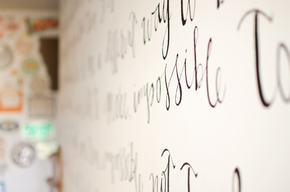 Handpainted song lyrics on a wall. || RustopiaConsulting.com