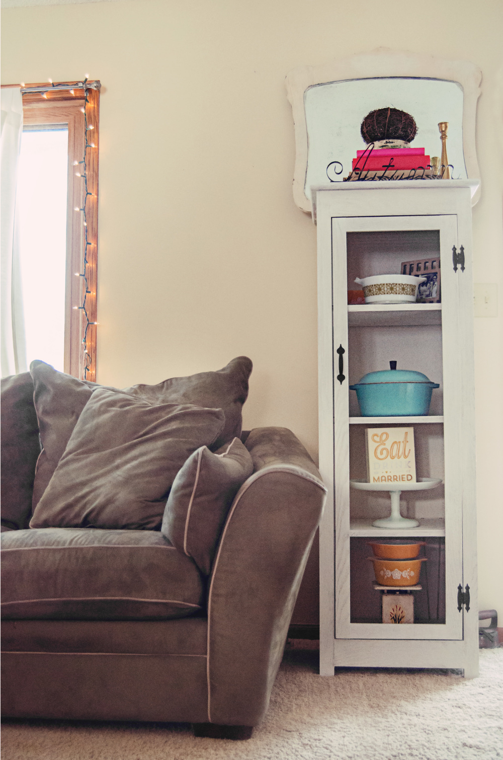 Shelf cabinet styled with vintage pieces. | hprallandco.com