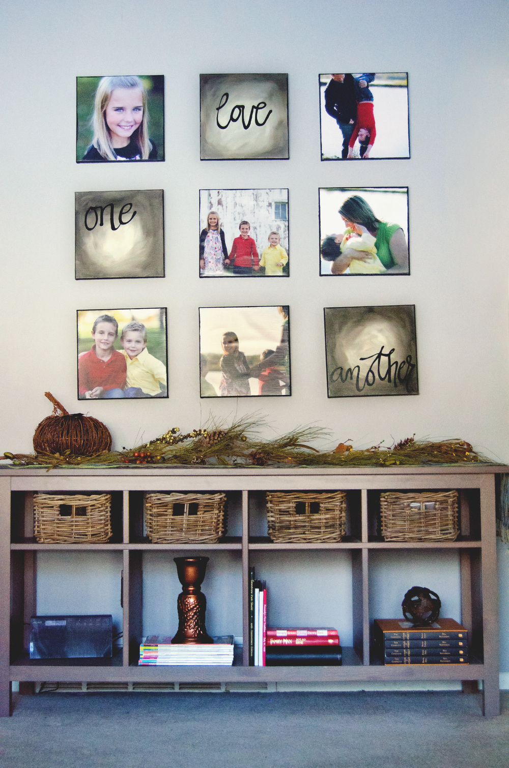 Gallery wall with square pictures over a storage bench. | hprallandco.com