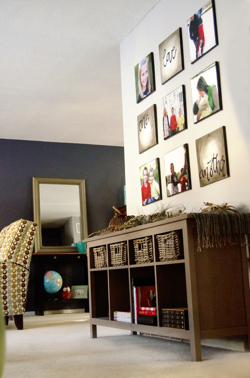 Gallery wall using square prints, hanging over a storage bench. | hprallandco.com