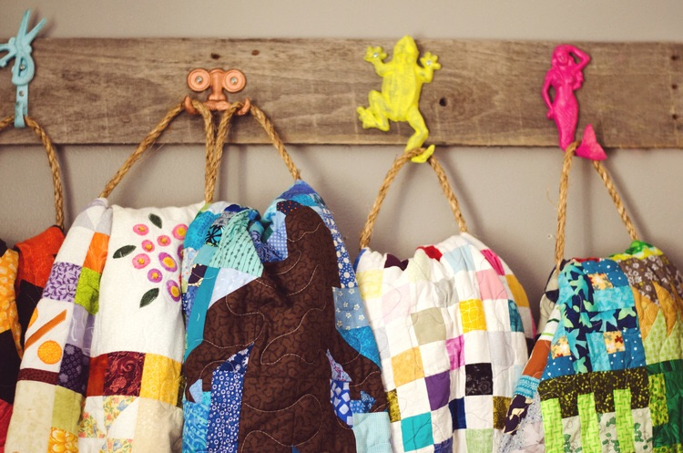 Colorful hooks to hang bright, colorful quilts. || RustopiaConsulting.com