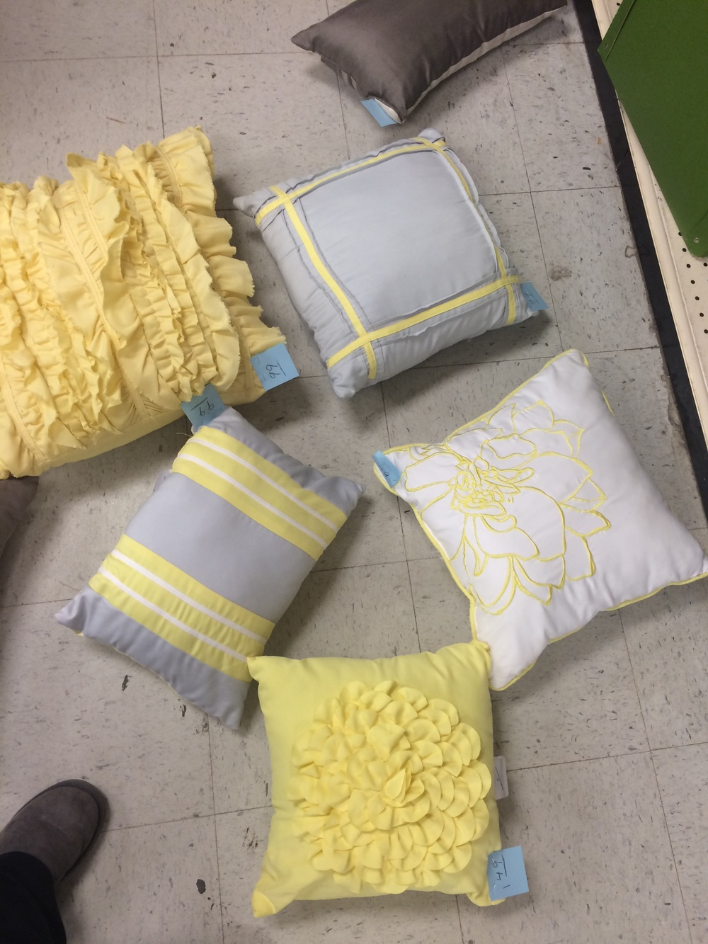 Thrifted yellow, white, and gray throw pillows. || RustopiaConsulting.com