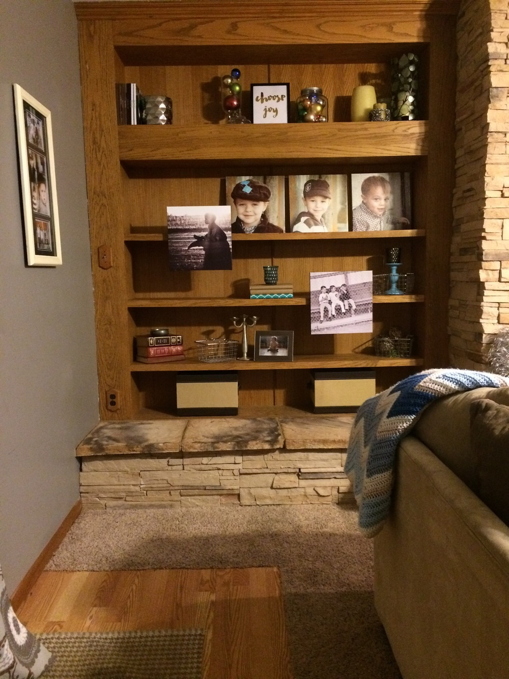 Built-in bookshelf styled with photographs. || RustopiaConsulting.com