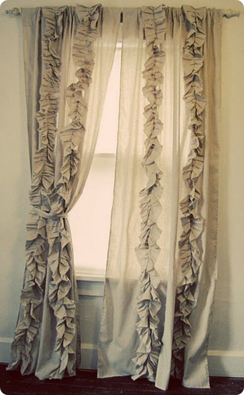 Ruffle curtains hanging on a window. || RustopiaConsulting.com