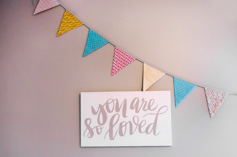 You are so loved wall art with a pennant banner. | hprallandco.com