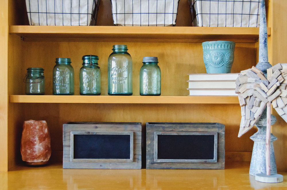 Blue vintage ball jars as shelf decor. | hprallandco.com