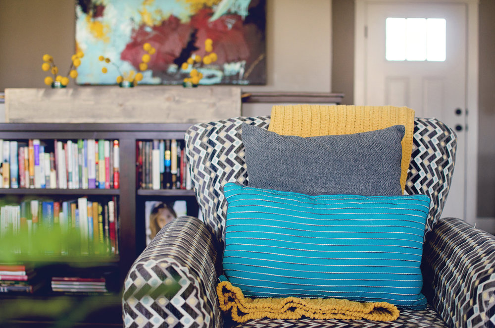 Patterned chair with bold color throw pillows. | hprallandco.com