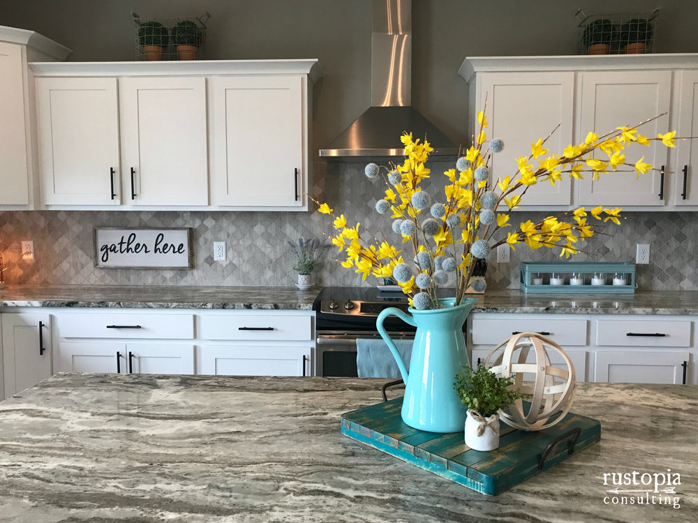 Kitchen counter vignette using a tray, pitcher, floral stems, and an orb | RustopiaConsulting.com