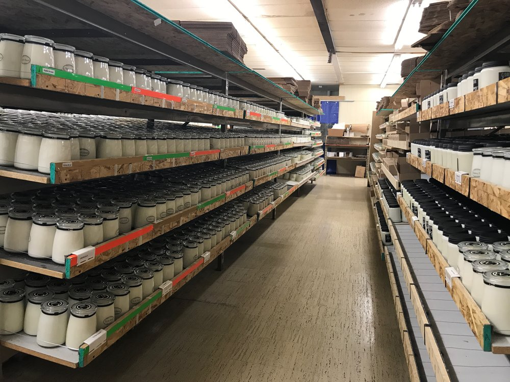 Shelves full of Milkhouse Candle Company candles. | RustopiaConsulting.com