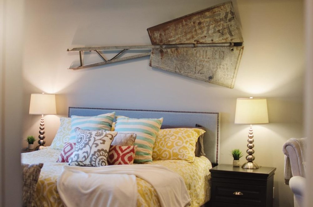 Master bedroom design with windmill wall decor | hprallandco.com