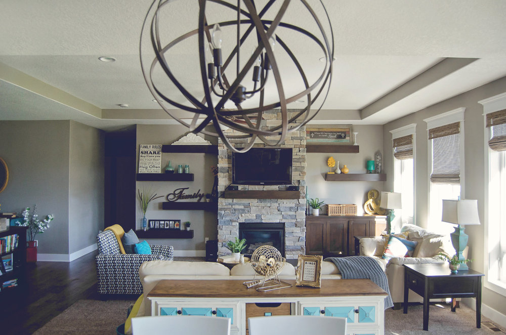 Living room design with pops of yellow and turquoise | hprallandco.com