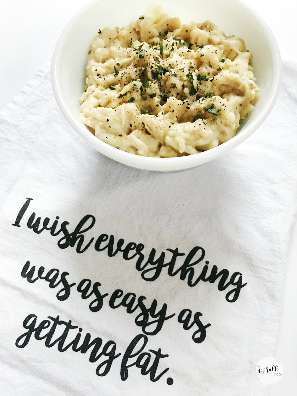 "White bowl full of Chicken and Noodles on a white kitchen towel that says, ""I wish everything was as easy as getting fat."" via  H.Prall and Co."