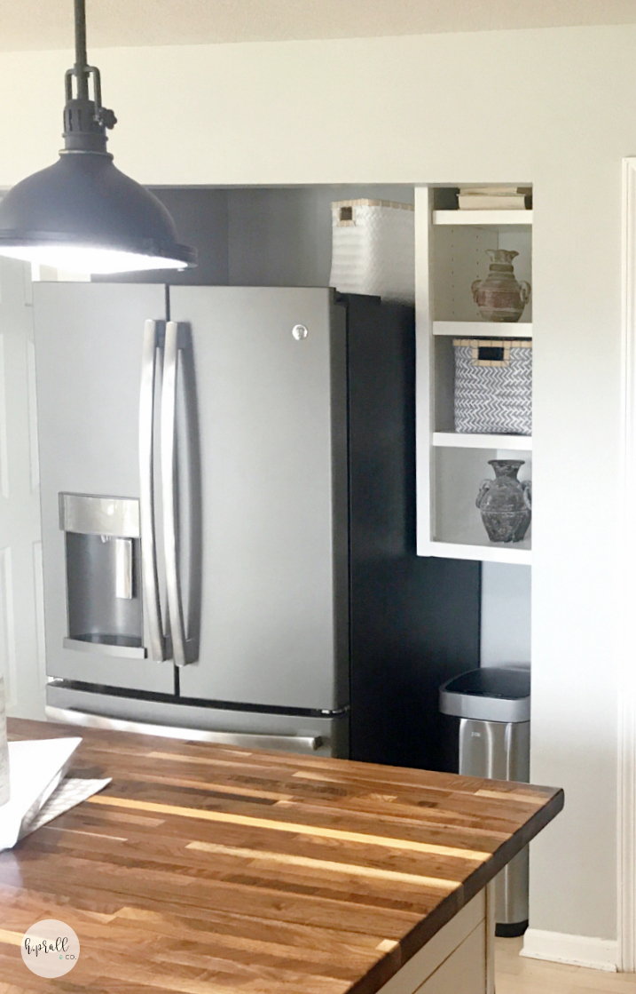 Custom storage space next to a refrigerator in a newly remodeled kitchen | hprallandco.com