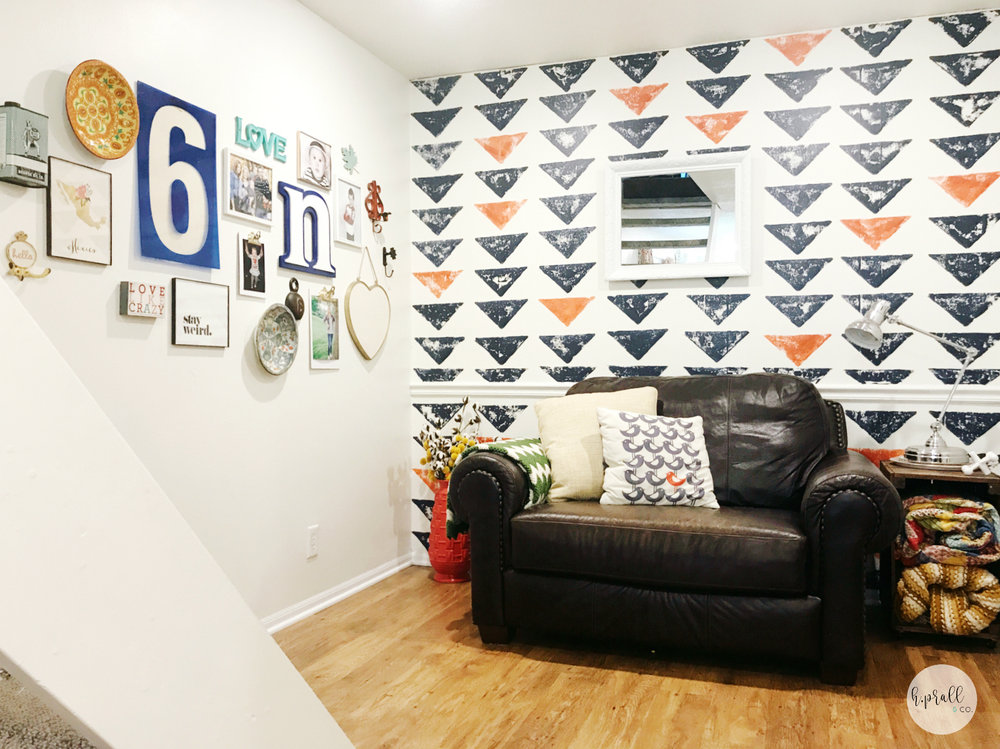 Bold wall design and gallery wall layout by H.Prall & Co.
