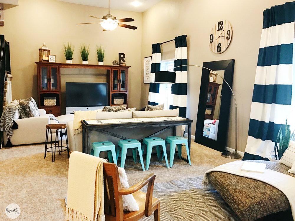 Additional seating created with a sofa table and aqua barstools | hprallandco.com