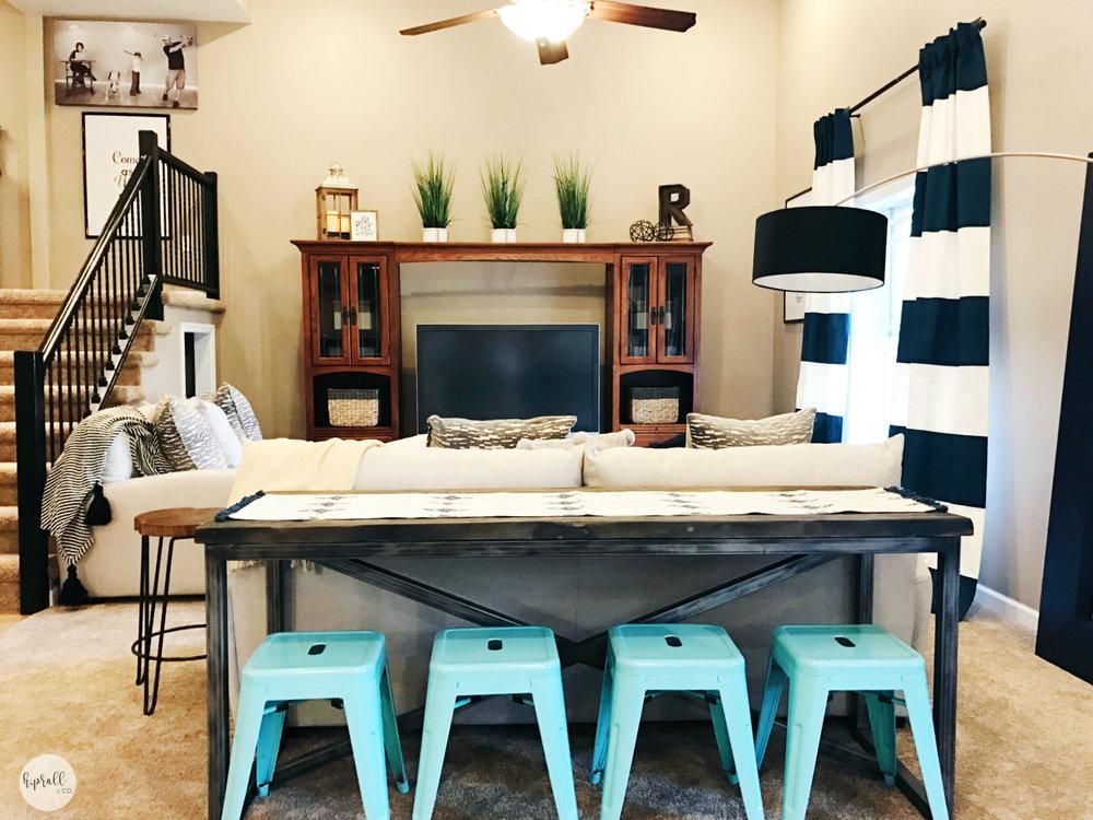 Aqua barstools + a sofa table create extra seating in a living space. | hprallandco.com