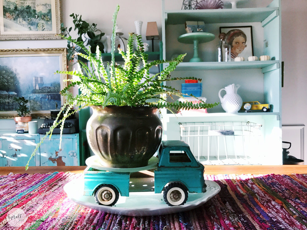Simple Centerpiece featuring a vintage truck and a potted plant. | hprallandco.com