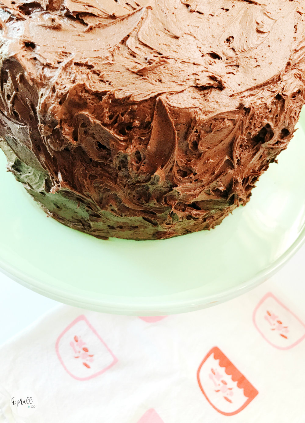 Triple Layer Chocolate Cake on a cake stand from H.Prall & Co. | Interior Decorating Blog | hprallandco.com