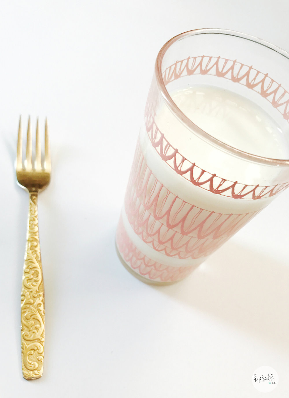 Glass of milk and a gold fork to go with Triple Layer Chocolate Cake | Interior Decorating Blog hprallandco.com