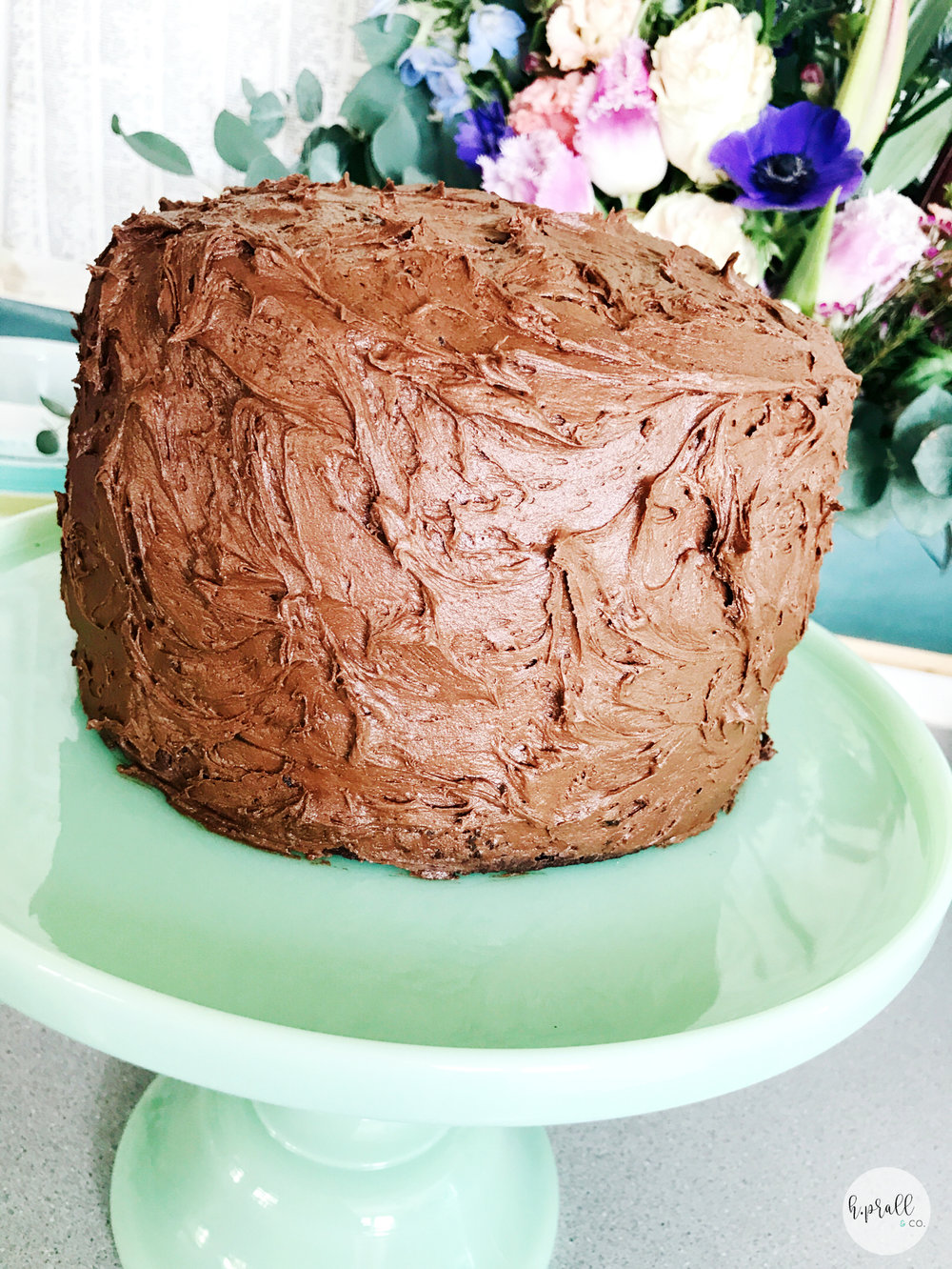 Triple Layer Chocolate Cake on a mint green cake stand | Interior Decorating Blog | Des Moines, IA | hprallandco.com