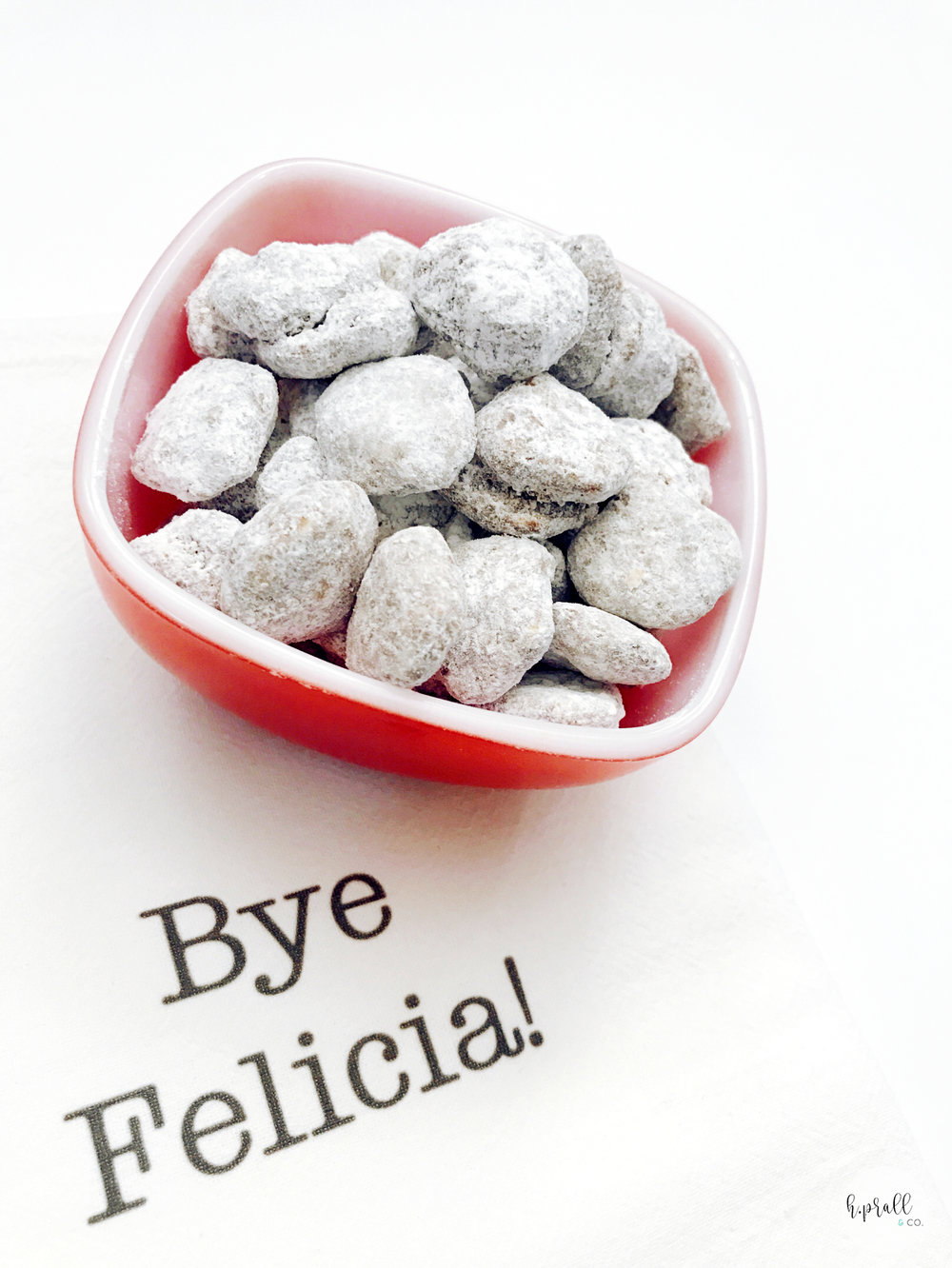Full bowl of puppy chow on a Bye Felicia kitchen towel.  Get the recipe at hprallandco.com.