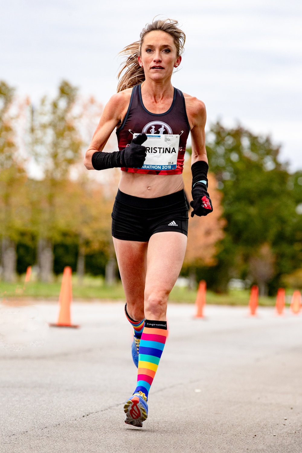 Christina Murphy, of Murphy Chiropractic & Performance Center, at mile 18. First female finisher, unofficial time of 2:40:43. With that time she qualifies for the 2020 Olympic Trials. Few more of my pics from the race are  here .
