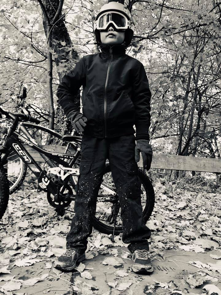 Ingredients for a fun picture: ski helmet and goggles, bikes, gloves, muddy trails 2 day after a 6 inch snow fall, and 7 yr old willing to embrace it all