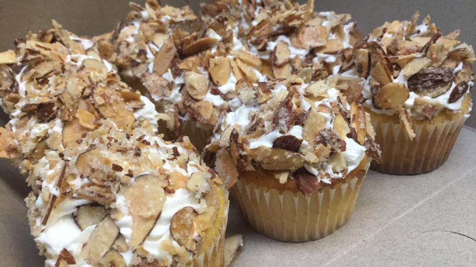 Burnt Almond Torte Cupcakes. Almond batter with a custard filling topped off with buttercream icing and candied almonds.