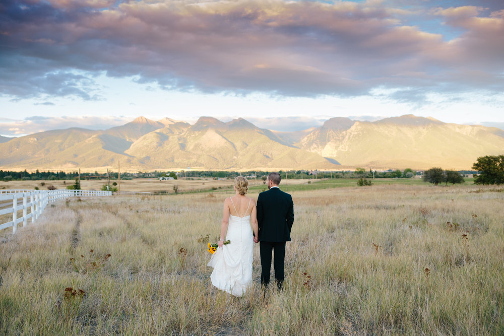 A stunning end to a big sky wedding.  Tracy and Matt, happy trails to you.  Photo by Dina Remi Studios.