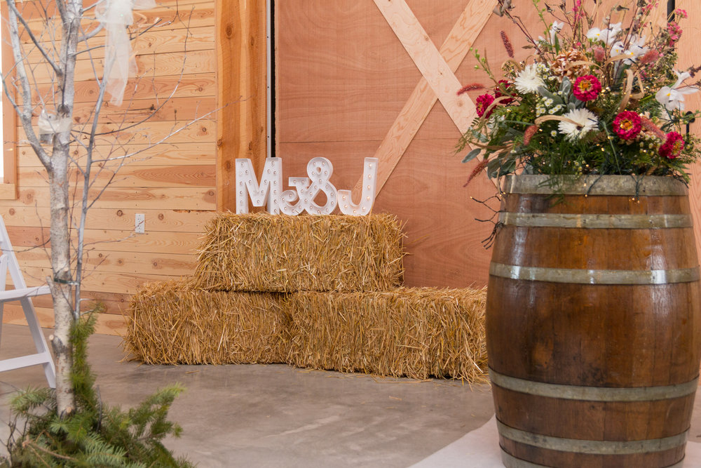 Winter Wedding Hay Bales and Wine Barrel
