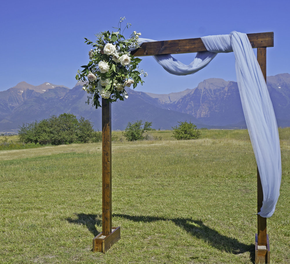 Rugged Horizon Wedding Arch Mission Mountains.jpg