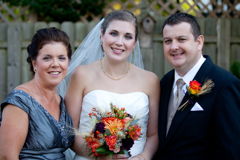 Marianne with her mom Linda and her husband Paul on their wedding day in 2011.
