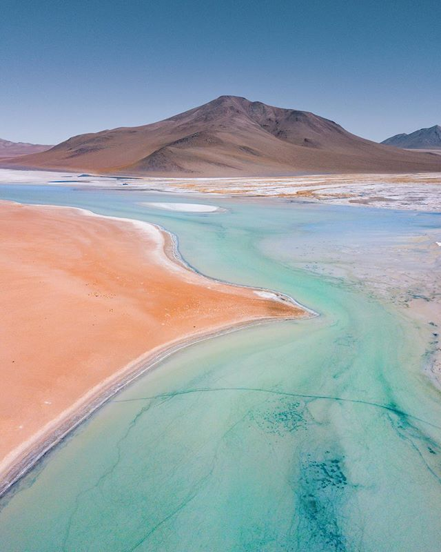 Otherworldly salt lakes in the high altitude desert of Bolivia 🌎 One of the most extreme, desolate, and incredible landscapes we drove through on our entire trip was the altiplano of southern Bolivia. We stopped at the edge of this beautiful lake at 14,500 ft for a quick dip in a natural hot spring surrounded by volcanos. 10.27.17 #AshLivin