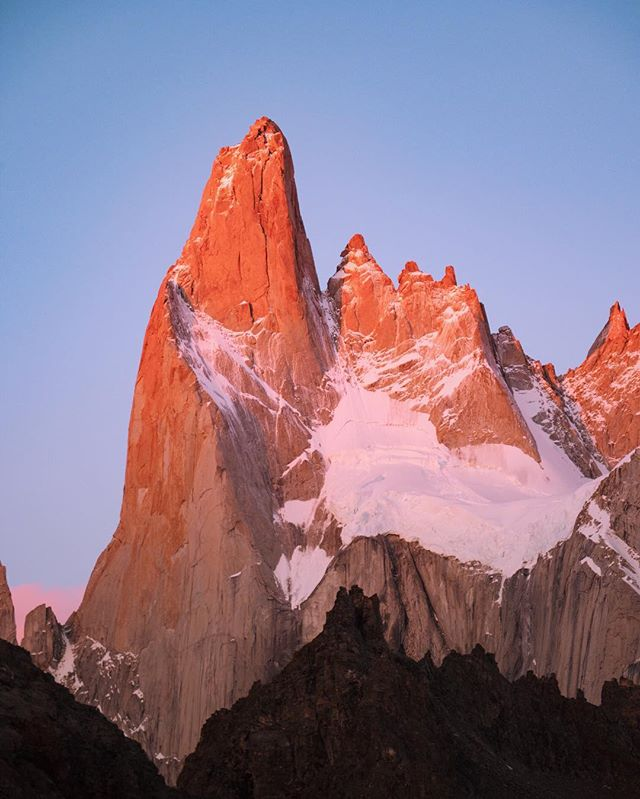 Sunrise, Patagonia style 🌅 Aguja Poincenot - a 4,200 ft tall needle of granite and part of the Fitz Roy massif - glows in the summer morning light. 1.9.18 #AshLivin