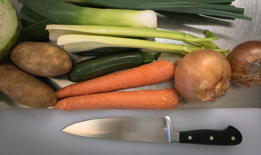 This is my new knife with the unsuspecting veggies. Little do they know what lies ahead.