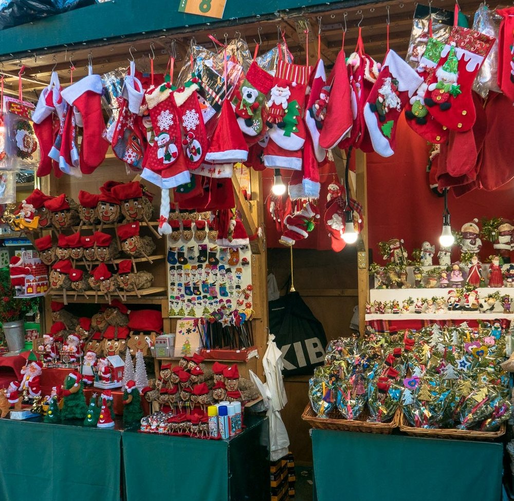 Silly stockings, Santa hats, and mistletoe in the Christmas market, Barcelona, Spain.