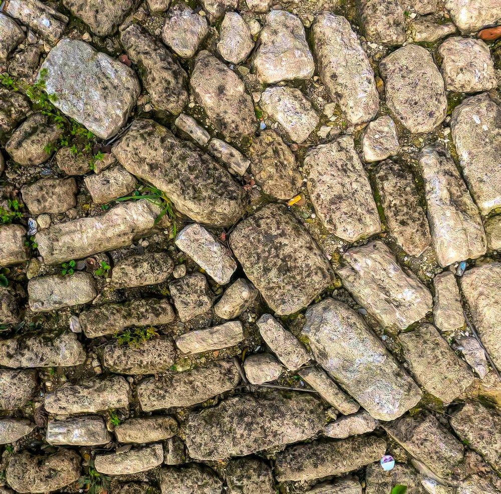 Old steps made of cobblestones, not concrete; no asphalt here.