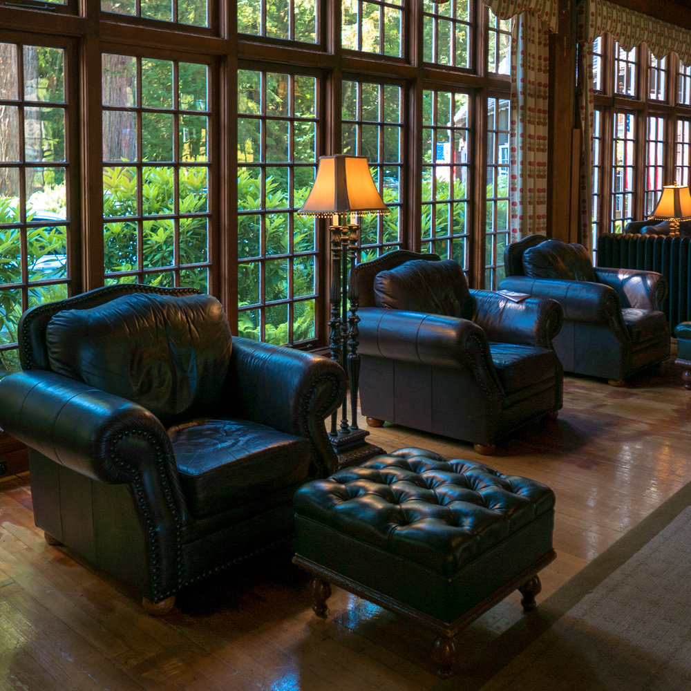 Handsome cozy chairs in the lodge's public space - lodge style done well.